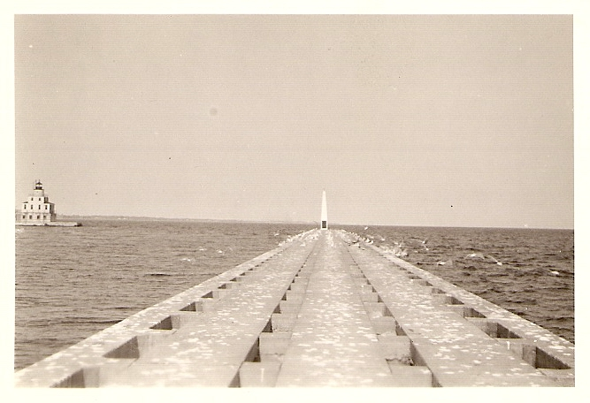 South side pier with northside lighthouse on the left. (1930s)