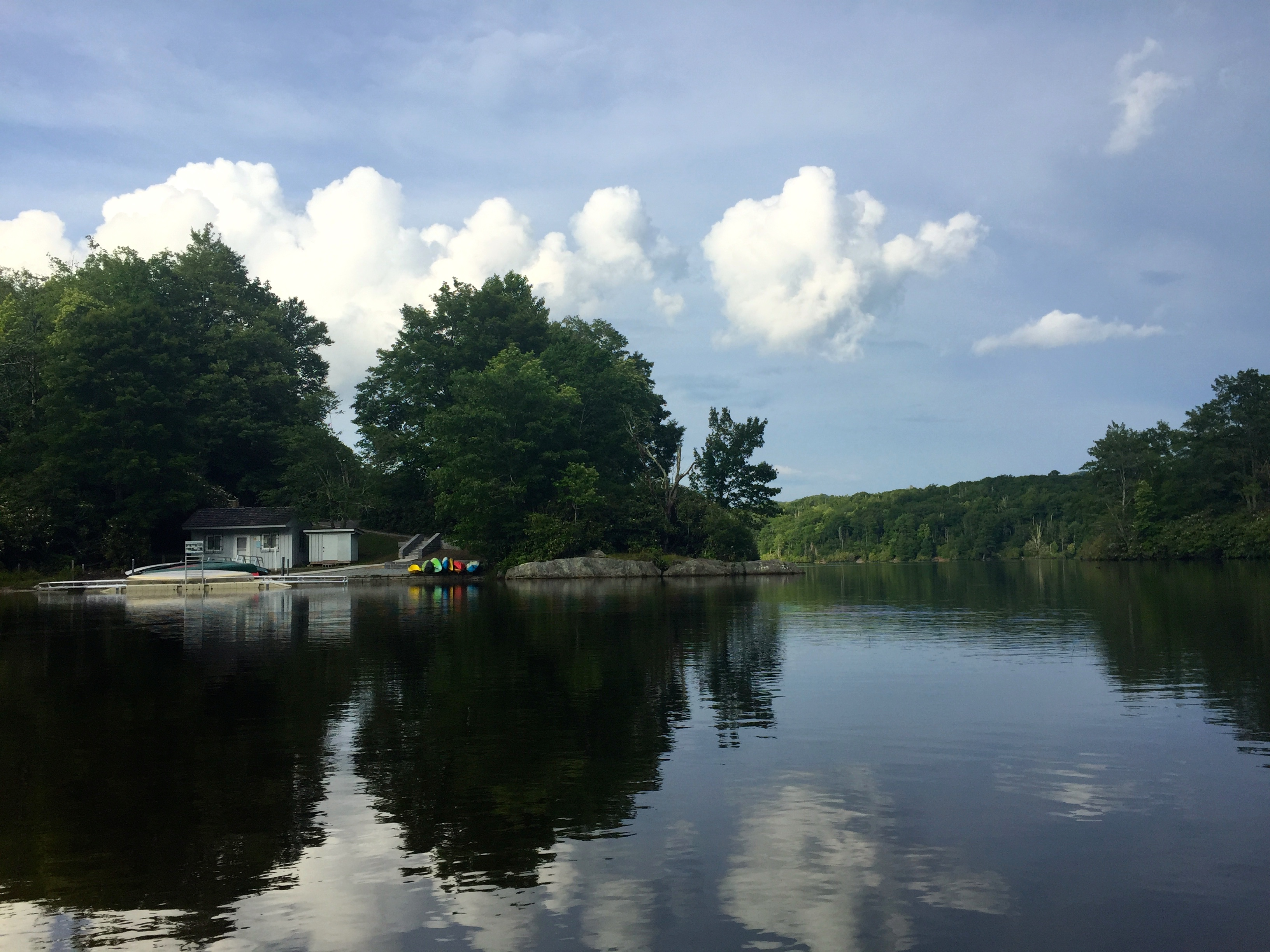 A view from the water of Price Lake Canoe and Boat Rentals, a small marina that is open from April to October.