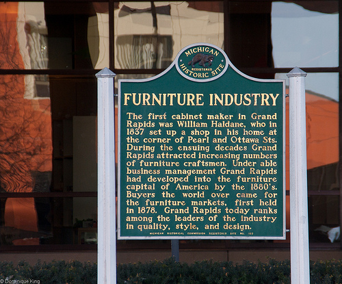 A historical marker in front of the Grand Rapids Public Museum at the corner of Pearl and Front Streets tells the story of the Furniture City