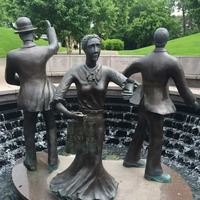 A memorial statue in front of the Ford Presidential Museum, dedicated to those who fought for better working conditions in the 1911 furniture factory strike