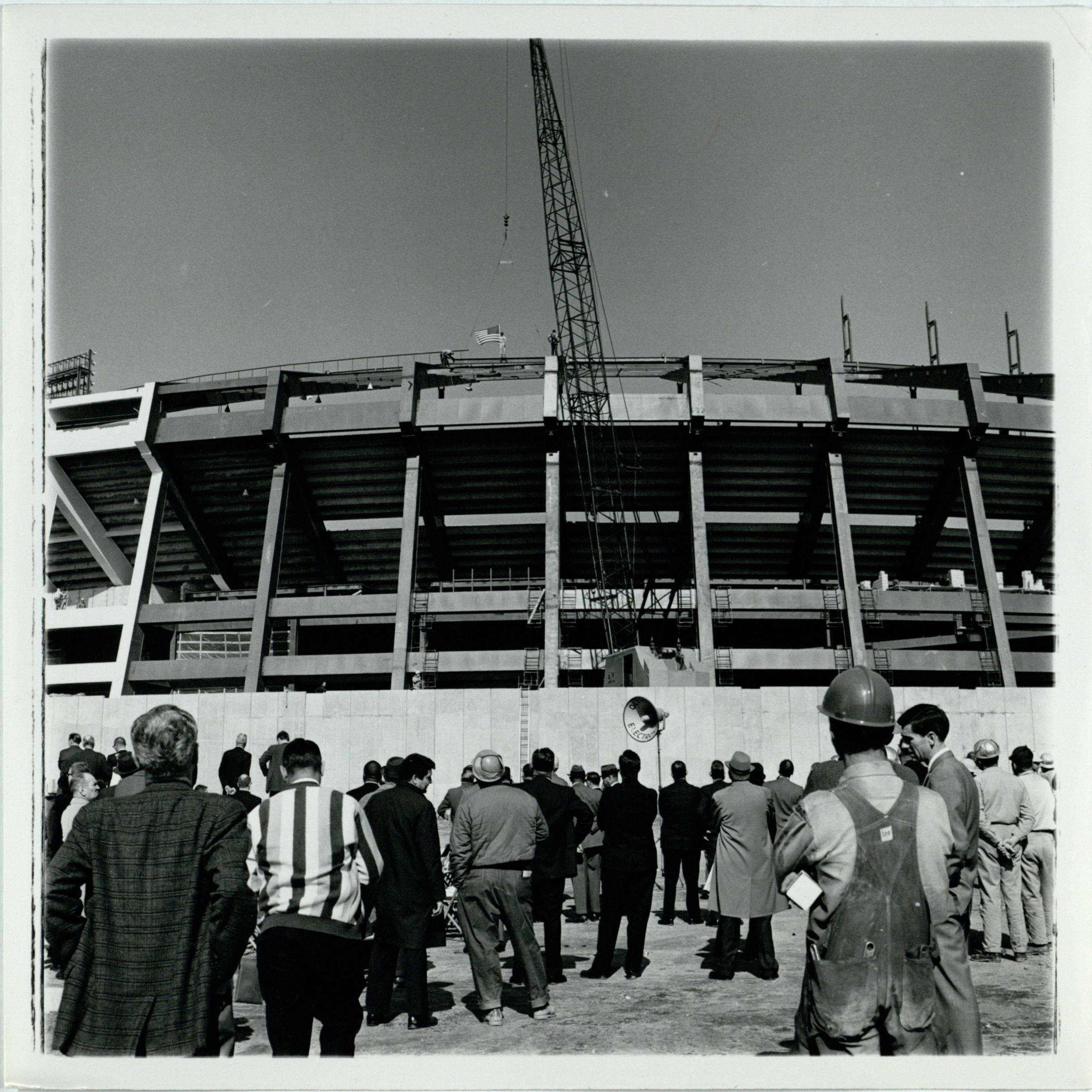 """""""Crowd Gathers Outside of Atlanta Fulton County Stadium to Watch the Construction"""" Unidentified photographer, circa 1965 AJCP142-010x, Atlanta Journal-Constitution Photographic Archive. Special Collections and Archives, Georgia State University Library"""