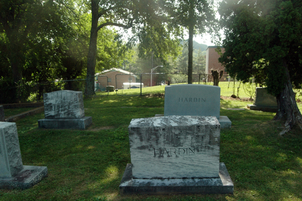 Near the back of the white section of the cemetery.The chain-link fence that separates the white section of the cemetery from the black section can be seen in the background.