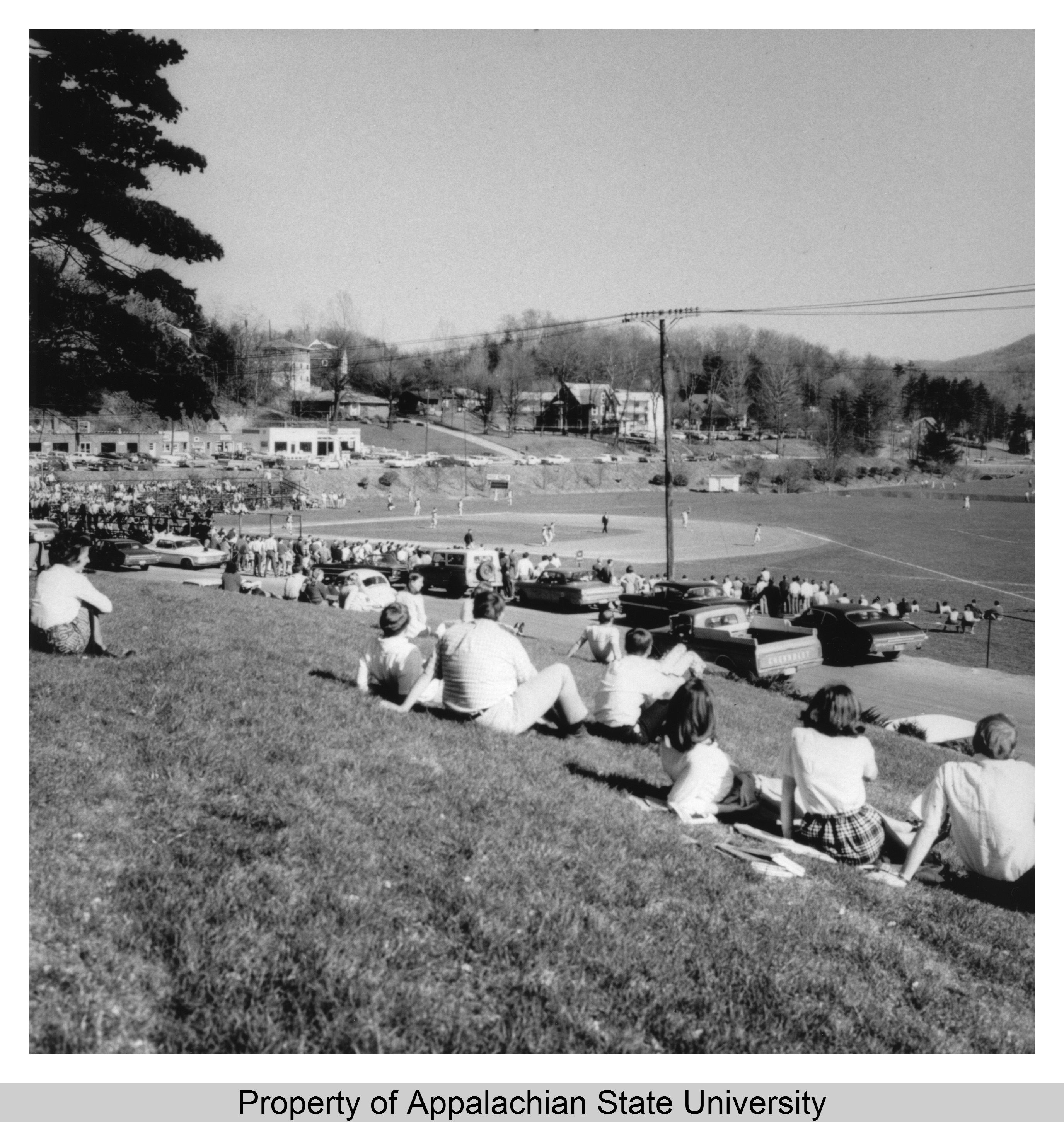 Students watch baseball in 1965 at Red Lackey Field, where Kraut Creek was piped underground and is now exposed in Durham Park.