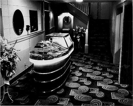 The glamorous green, white, & black theater interior.
