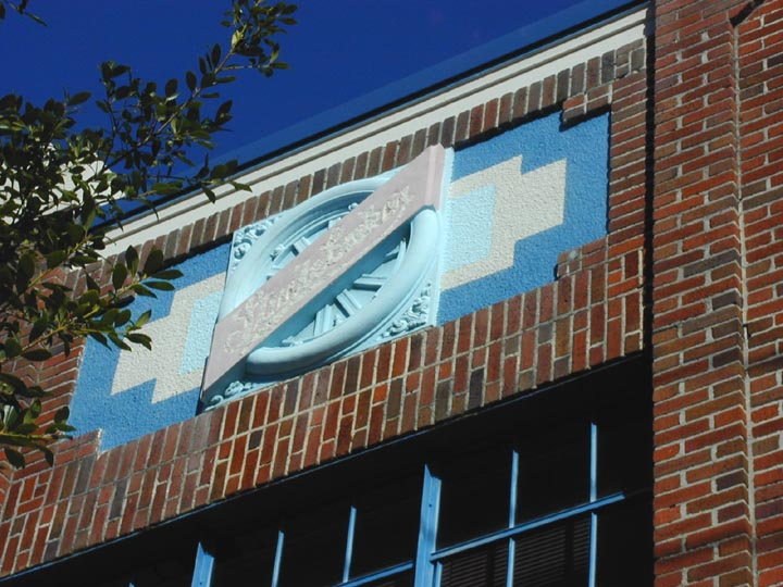 The Studebaker logo can still be seen above the windows of the building.