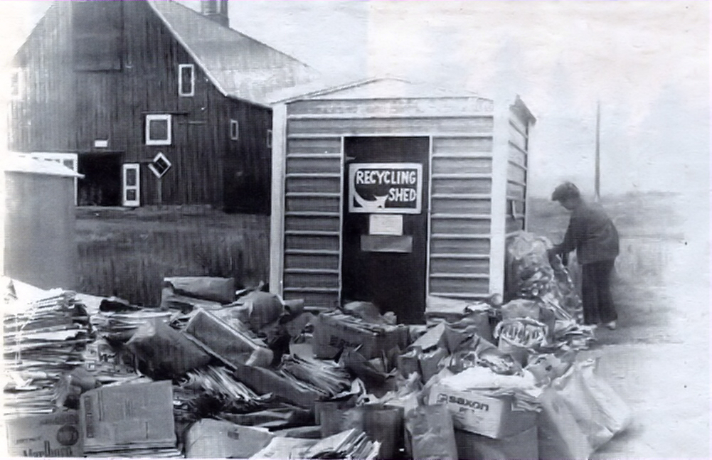 The 1977 view of Cheney's early recycling efforts.  Recycling days were the 3rd Saturday of the month and Eastern Washington University allowed the recyclers to locate their shed at the Red Barn parking lot.