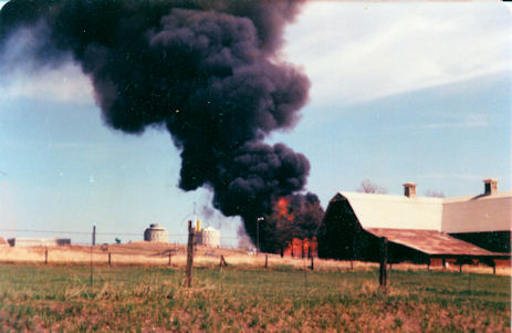 The back of the barn is visible in this photo of the April 25, 1977 fire that destroyed the Memorial Fieldhouse along Washington Street on the Eastern Washingtion University campus.