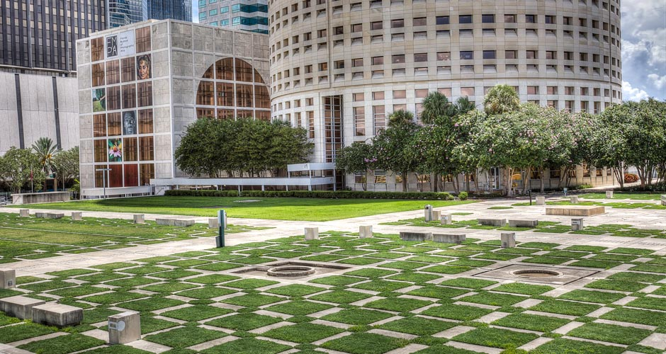 Kiley Gardens features a checkerboard pattern of grass and concrete that mirrors the nearby Rivergate Tower.