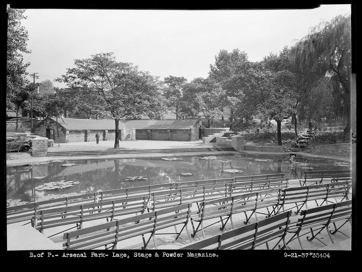 Same amphitheater with a small lake and seating during another time.