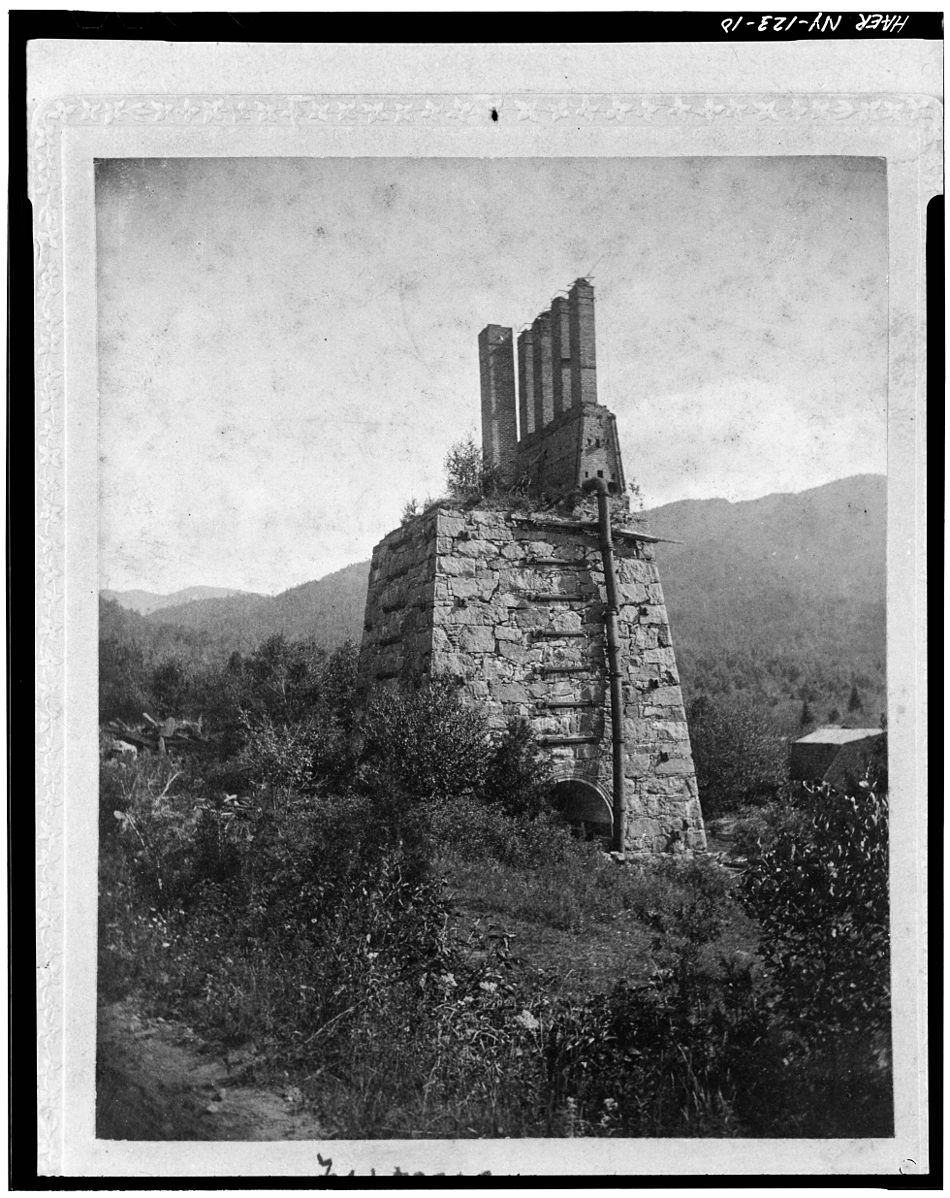 Stack at the 'New' Furnace, Ca. 1900  Photocopied June 1978. STACK AT THE 'NEW' FURNACE, CA. 1900. SOURCE UNKNOWN. OBTAINED FROM TAHAWUS CLUB. Attributed by unknown employee of the United States Government [Public domain] via Wikimedia Commons