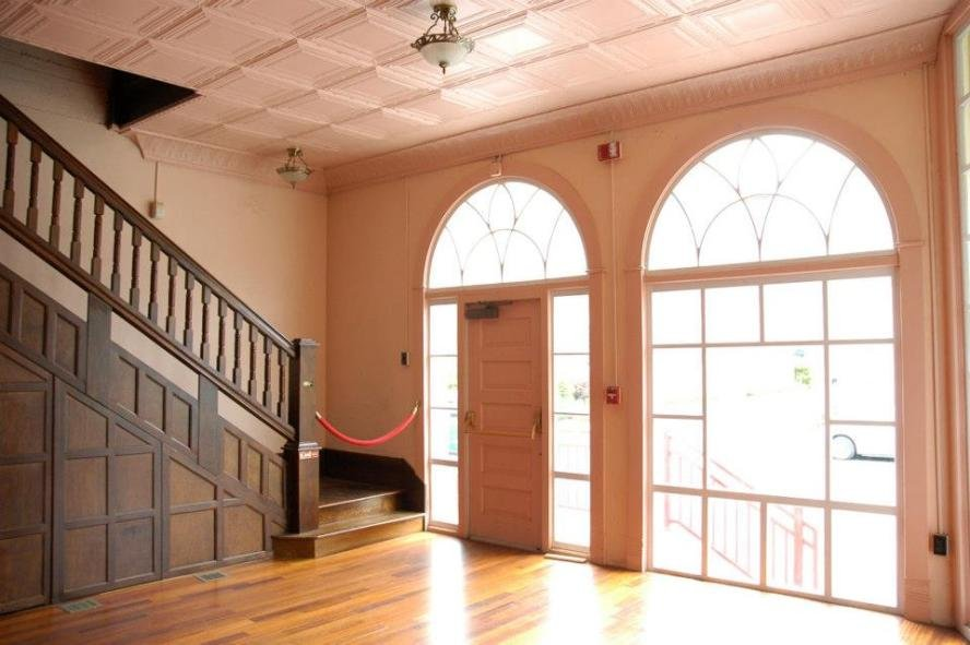 Photo of the entry with the pressed metal ceilings visible