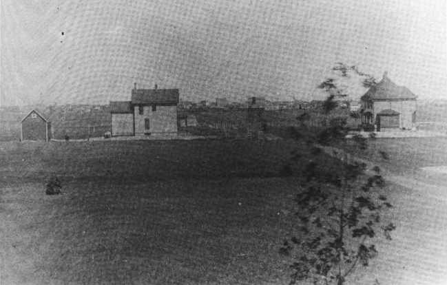 An 1888 photo of Aberdeen taken by L. Frank Baum. Main street can be seen in background. The home on the left is the Baum home.