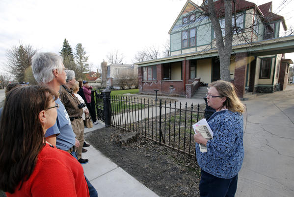 A volunteer leads a walking tour through the district