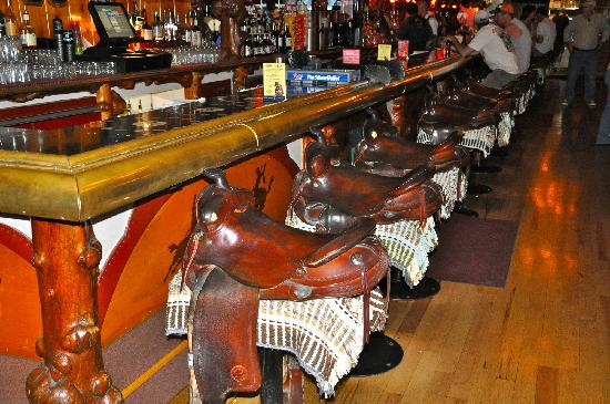 The infamous horse saddle bar stools at the Million Dollar Cowboy