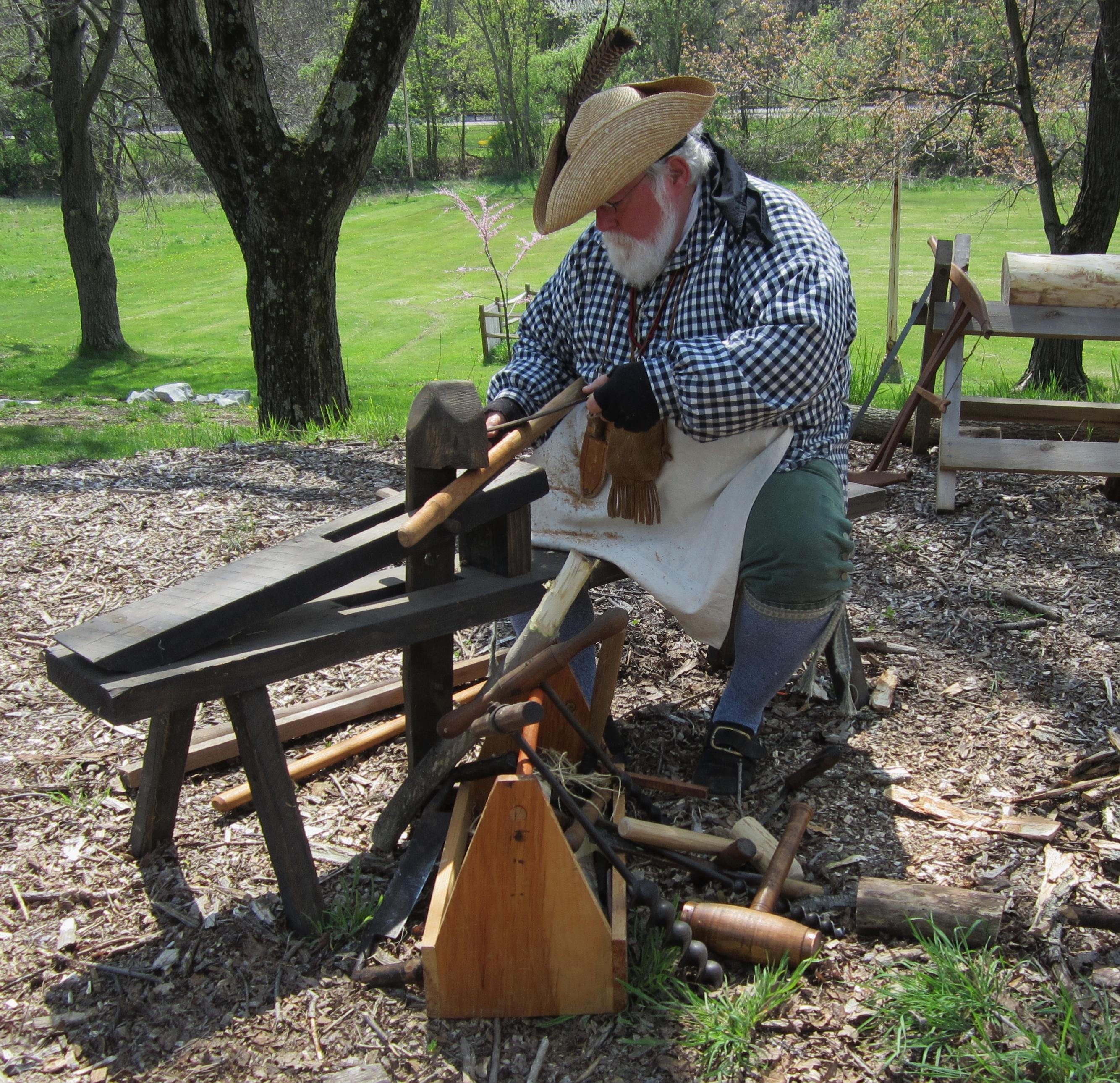 A volunteer woodworker demonstrating frontier techniques.