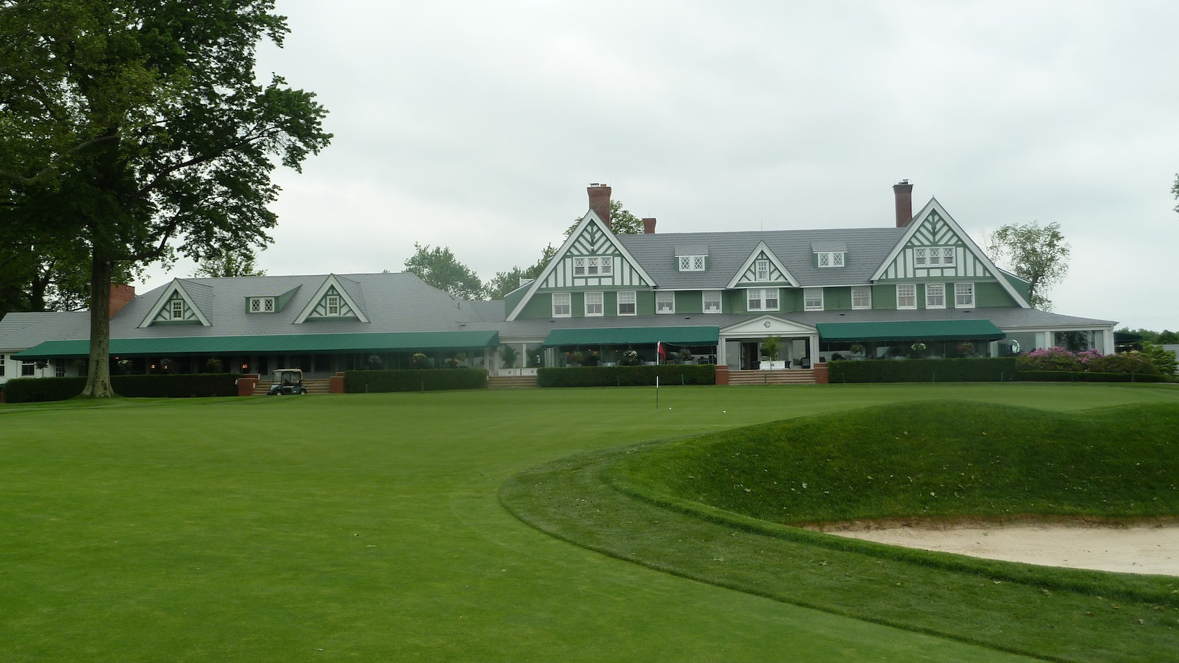The renovated club house with 18th green in the foreground.