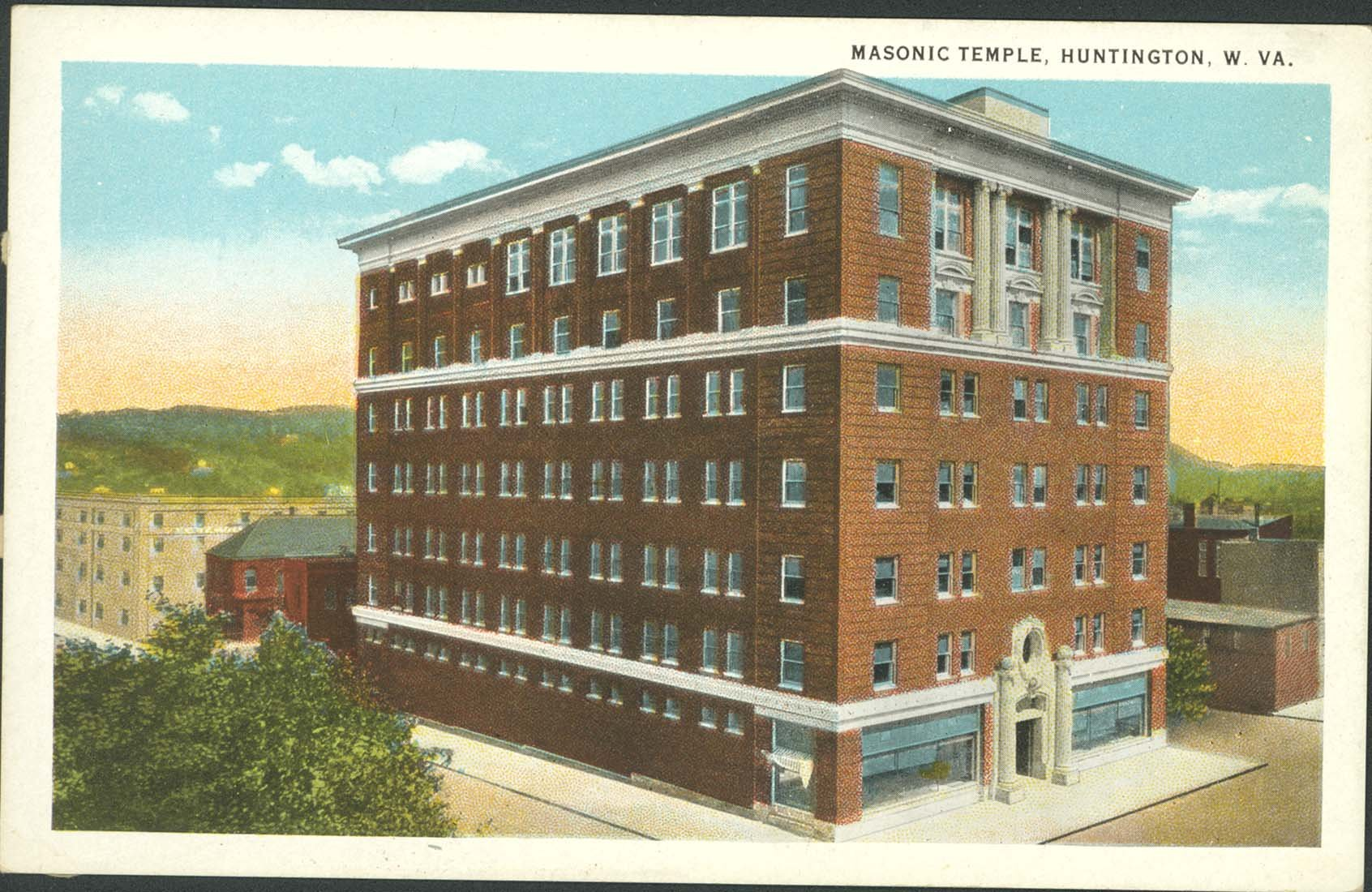 This early postcard of the Masonic Temple shows the building before the construction of the eastern half in 1922. Image courtesy of Marshall University Special Collections .
