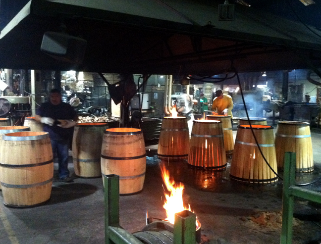 A view of the barrels before and after they are fired and charred.