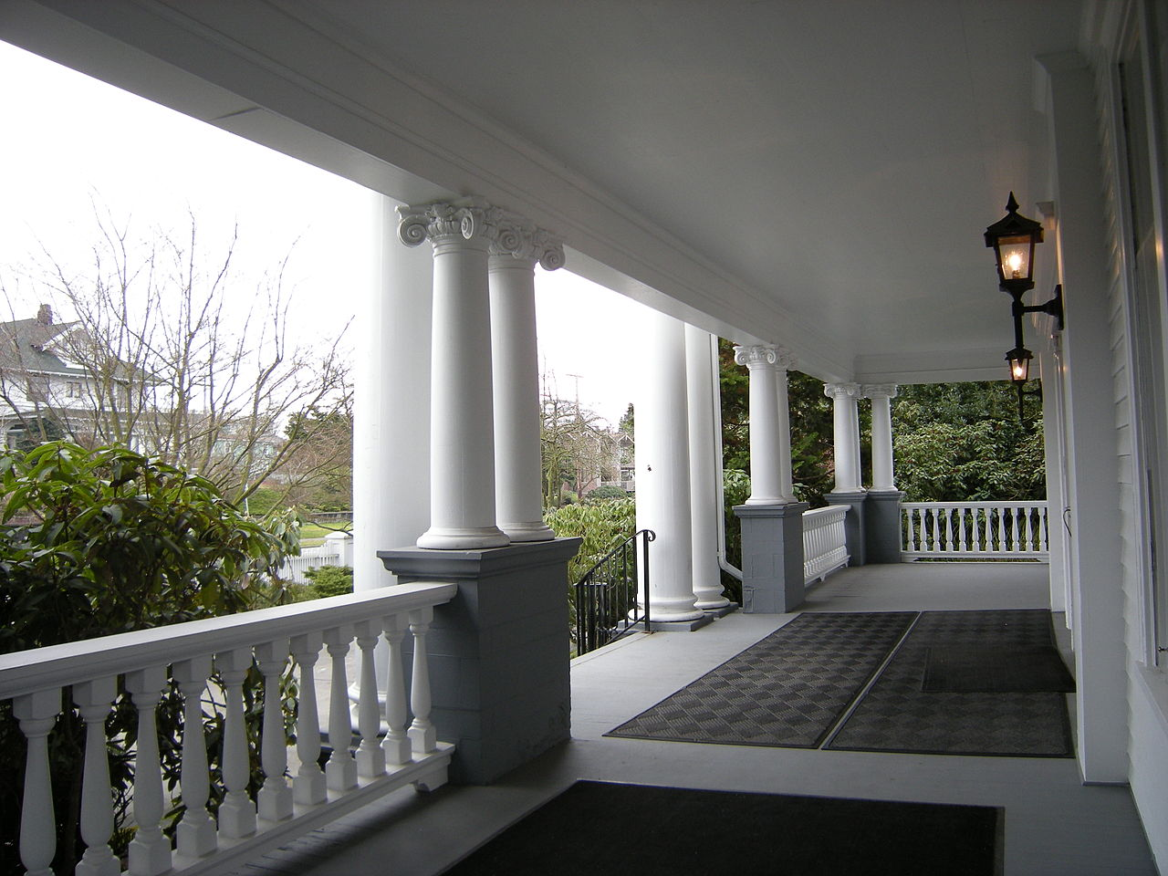 The house features a two-story porch with Corinthian and Ionic columsn.
