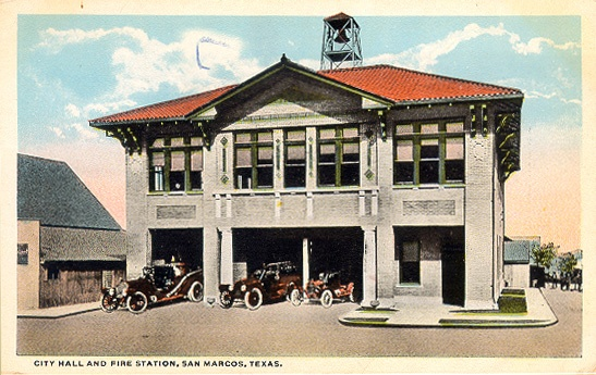 This postcard of the city hall and fire department was likely taken in the late 1920s.