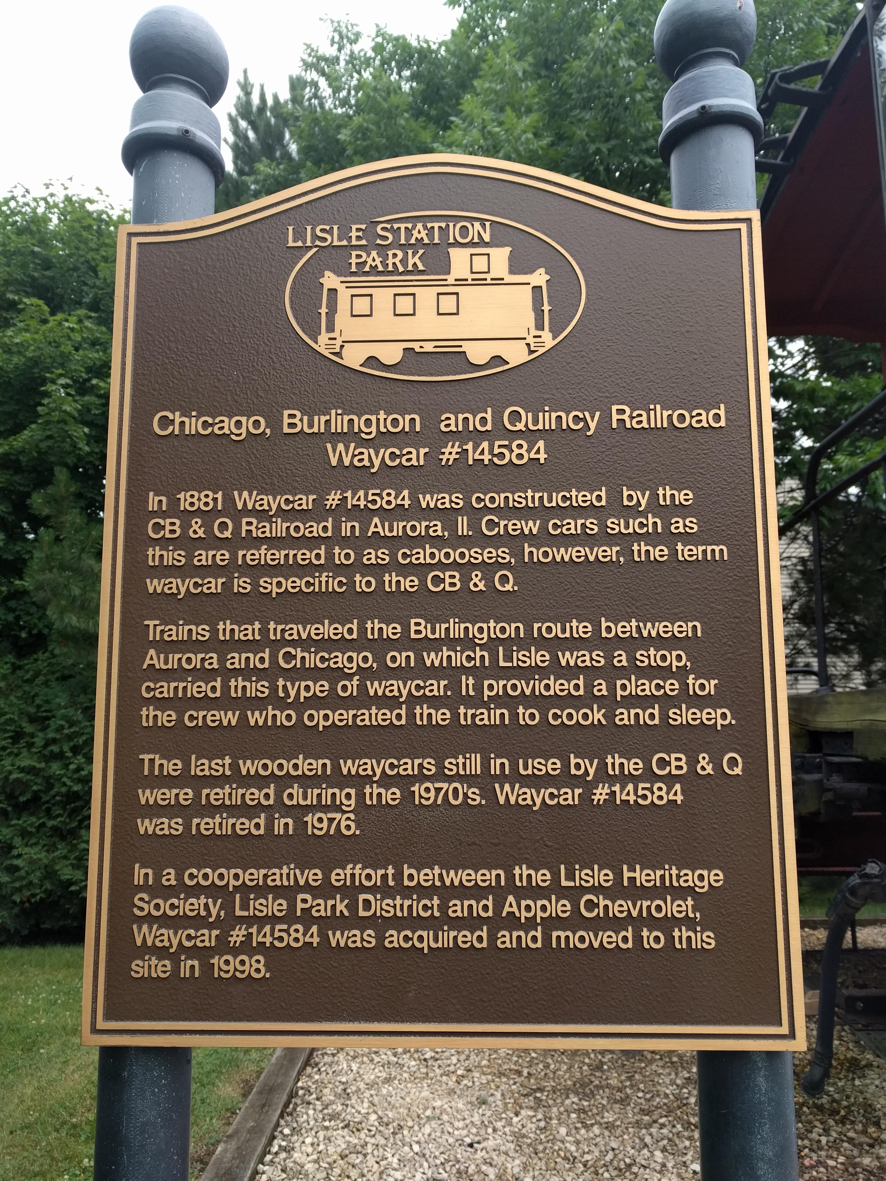 MLSP plaque about this caboose car