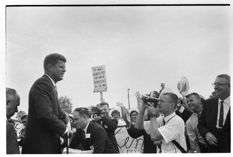JFK smiles for the press before the rally at College Stadium.