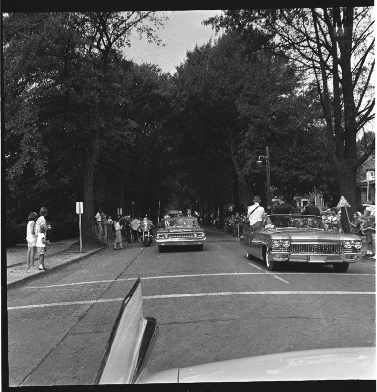 The motorcade of John F. Kennedy parades down 5th street in Greenville, North Carolina.
