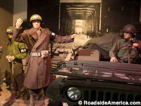 Diorama of an MP directing traffic across Remagen Bridge during WWII