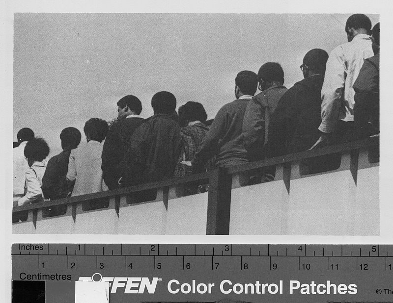 Black student walk out of the Ficklen Stadium at President Leo Jenkin's convocation on March 31st, 1969.