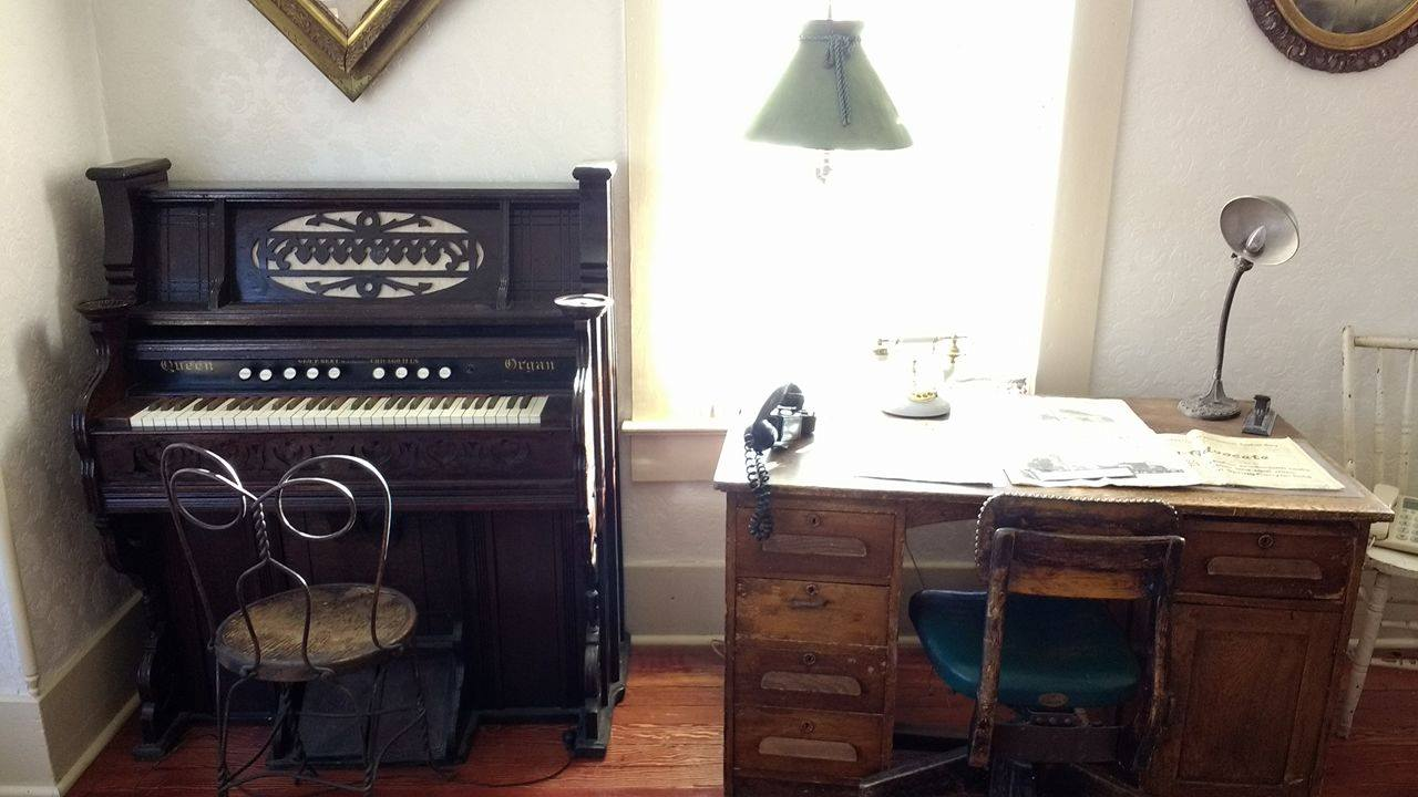 Organ and desk in parlor room
