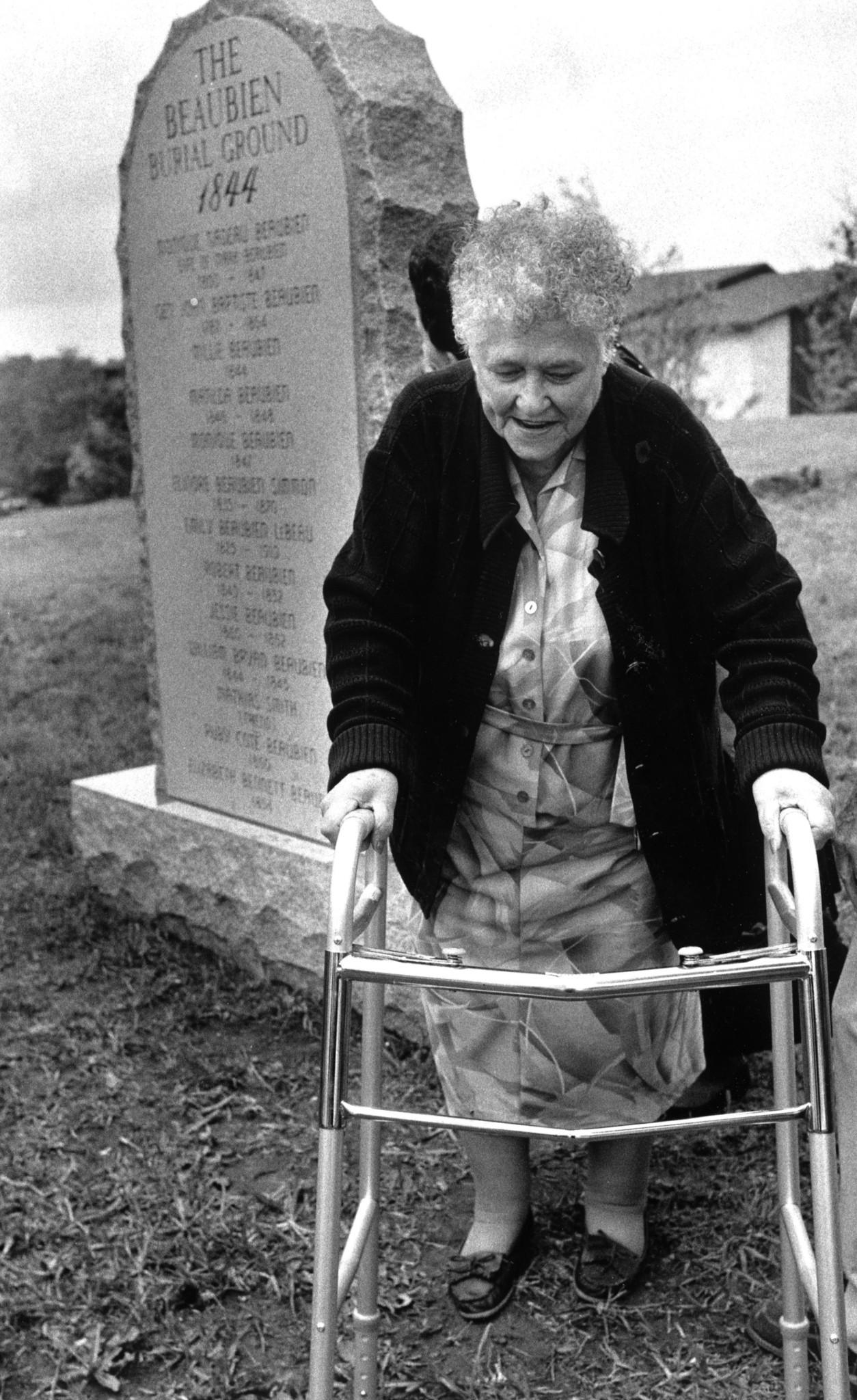 """Marjorie Sanborn, 77, great granddaughter of Marc Beaubien, walks away after ceremonies unveiling the new memorial to her ancestors in Lisle. - Nancy Stone / Chicago Tribune."" (Photo gallery: A history of Lisle. Chicago Tribune, accessed 4/1/2020.)"
