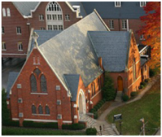 Aerial view of the church to show to cross shape of the building, with the parish house behind the church.