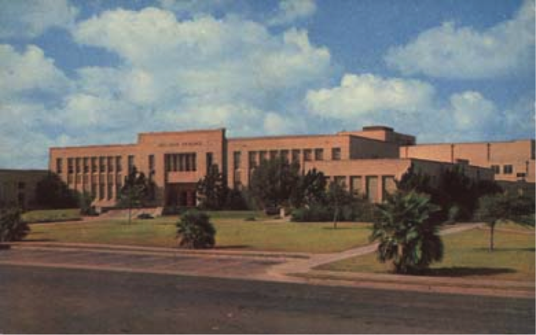 Photograph showing one of the education buildings on the campus of Del Mar College. The pictured edifice is known as the Memorial Classrooms building, and is still in use today by faculty and students more than 75 years later.
