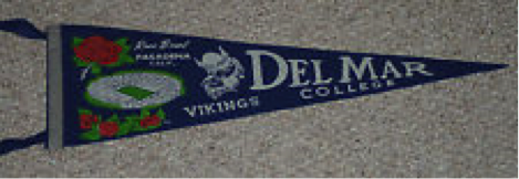 A photograph of a vintage pennant for Del Mar University from the 1950's. It is a special edition from the Rose Bowl.
