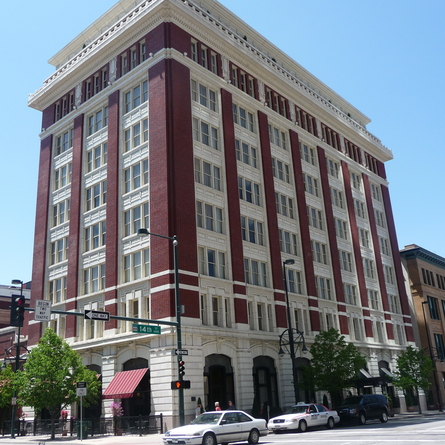 This historic building was designed in the Renaissance Revival style of architecture and featuresterra cotta and coffered plastered ceilings.