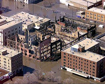 The Security, New Hampshire Apts. (center of remains), and Dinnie Buildings destroyed by ire during the Red River flood of 1997