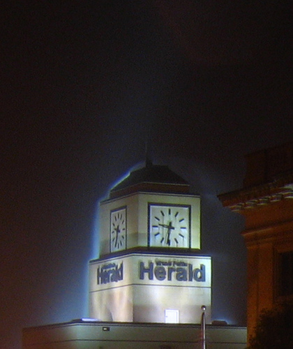 New Herald building and clock tower at night