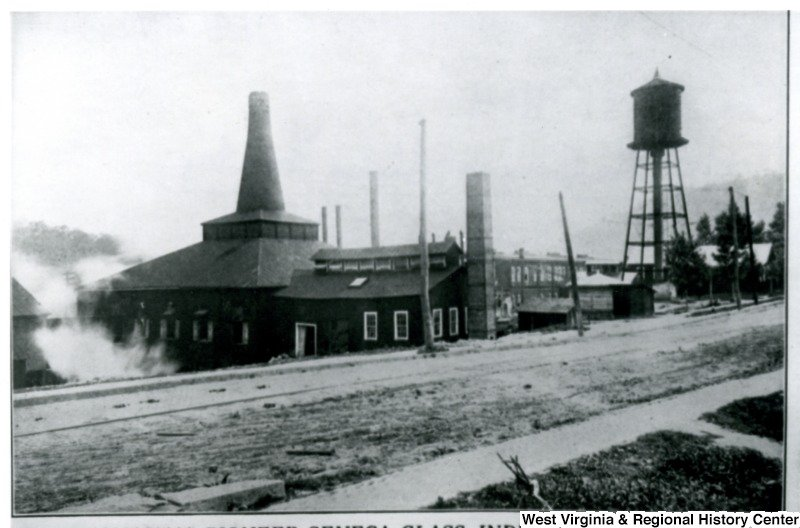 Seneca Glass Factory in the early twentieth century. The water tower and most of the smokestack still stand today. Courtesy of the West Virginia and Regional History Center, WVU Libraries.