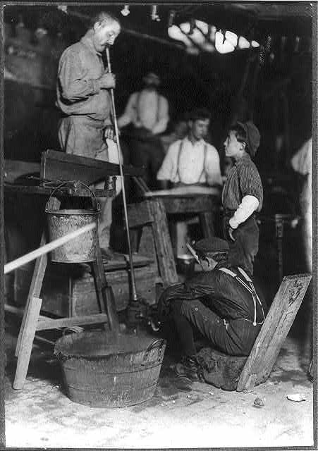 Photograph of a glass blower and mold boy by Lewis Hine, who documented child labor in the early twentieth century. Photo October 1908, courtesy of the Library of Congress.