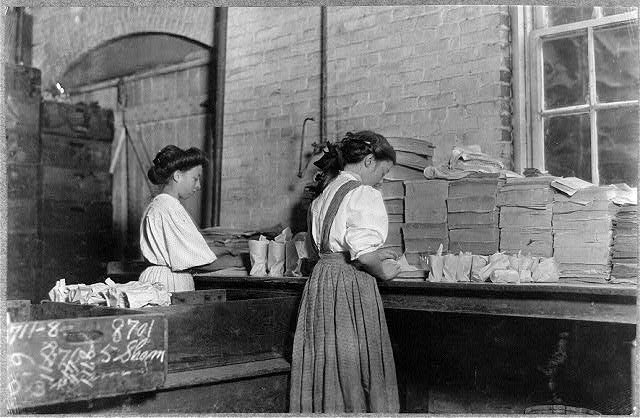 Girls at Seneca Glass wrapping and packing finished glass products. Photo by Lewis Hine, October 1908, courtesy of the Library of Congress.