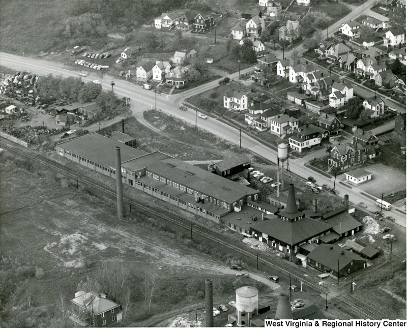 A view of Seneca Glass's strategic location between the Monongahela River and Beechurst Avenue. The Sunnyside neighborhood is located within walking distance. Photo circa 1955, courtesy of the West Virginia and Regional History Center, WVU Libraries.