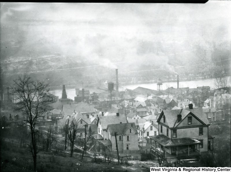 A 1915 view of Morgantown's Sunnyside neighborhood with the Seneca Glass Factory's smokestacks and water tower. Courtesy of the West Virginia and Regional History Center, WVU Libraries.