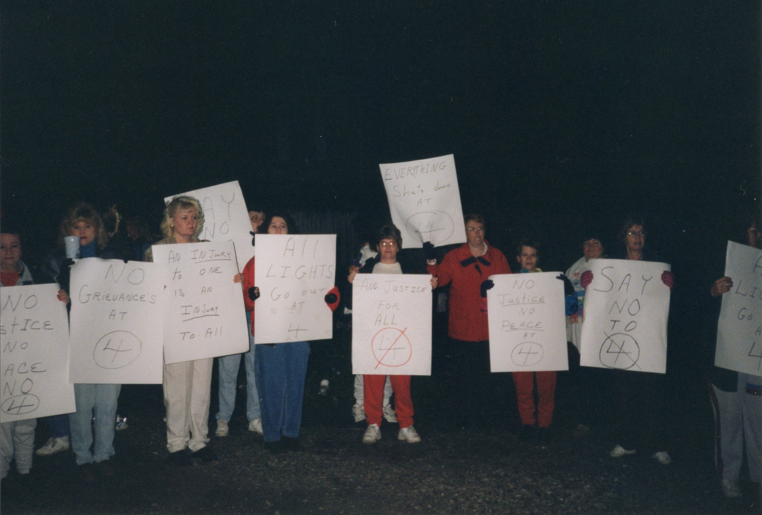 Corbin Ltd. Employees on strike in park across from Vernon St. Factory, Huntington, WV, 1991