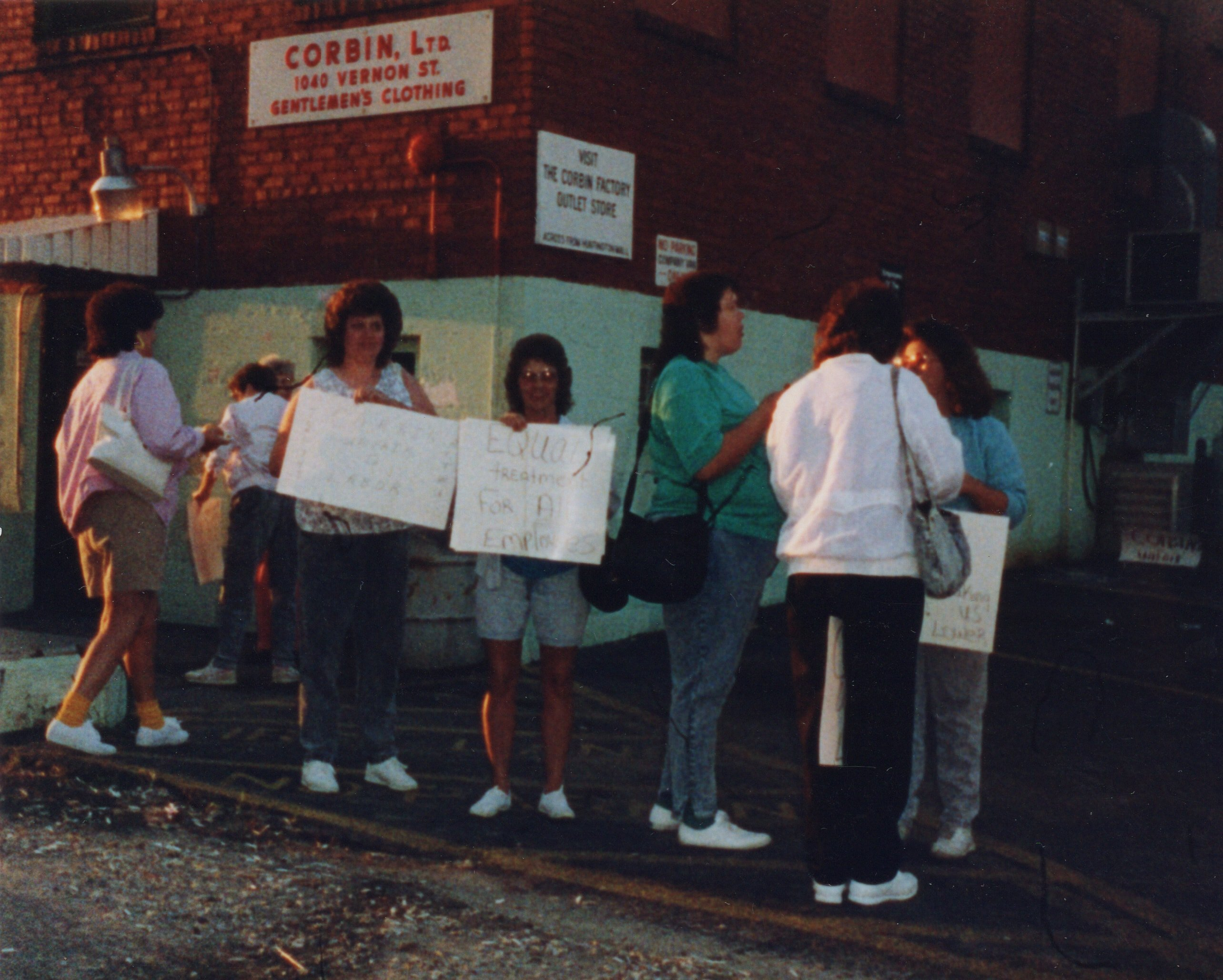Corbin Ltd. Machine Operators Nancy Lewis and Mae Adkins, on strike in front of Vernon St. Factory, Huntington, WV, 1991
