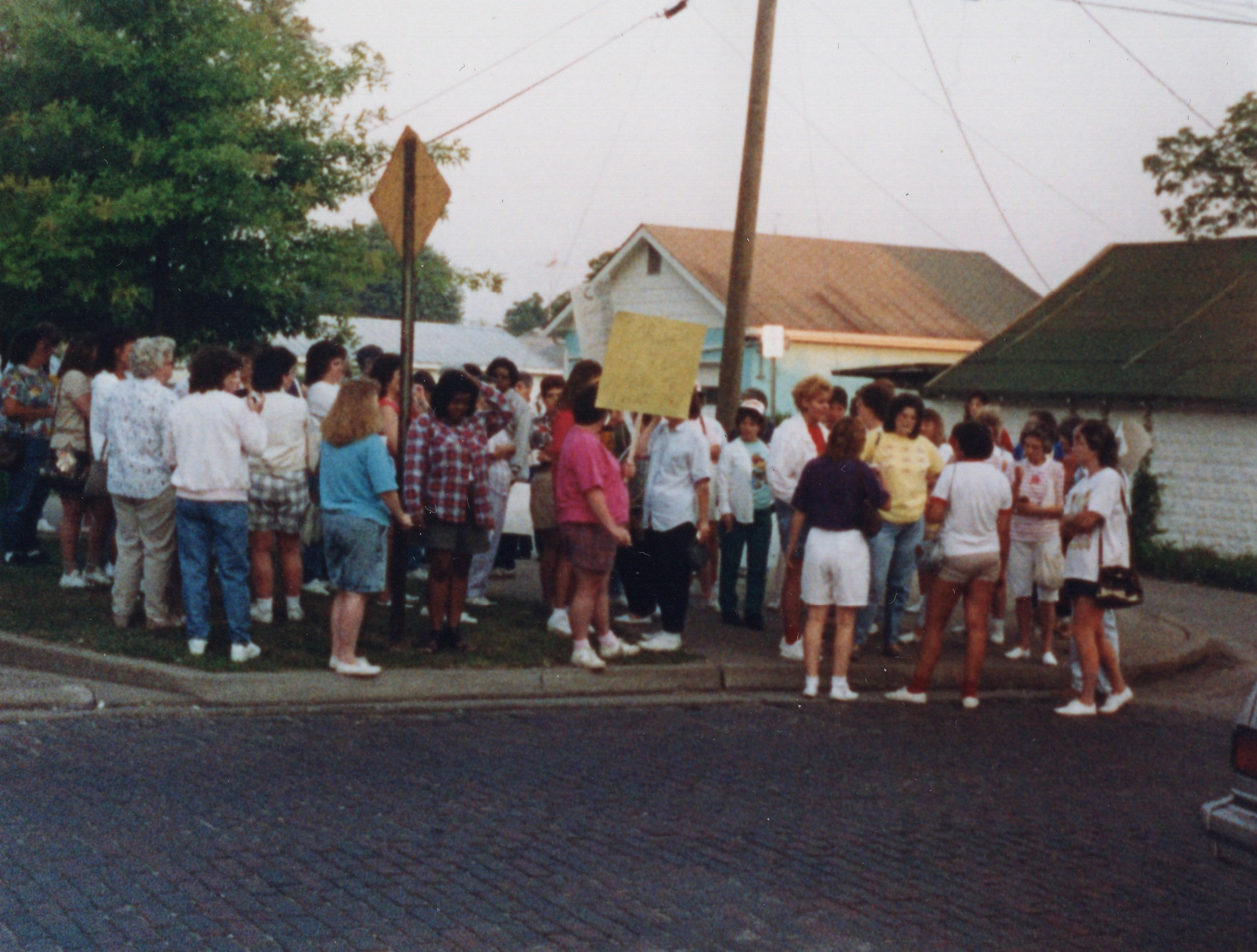 Corbin Ltd. Employees on strike protesting managers' desire that every employee work multiple sewing jobs at the Factory, in park across from Vernon St. Factory, Huntington, WV, 1991
