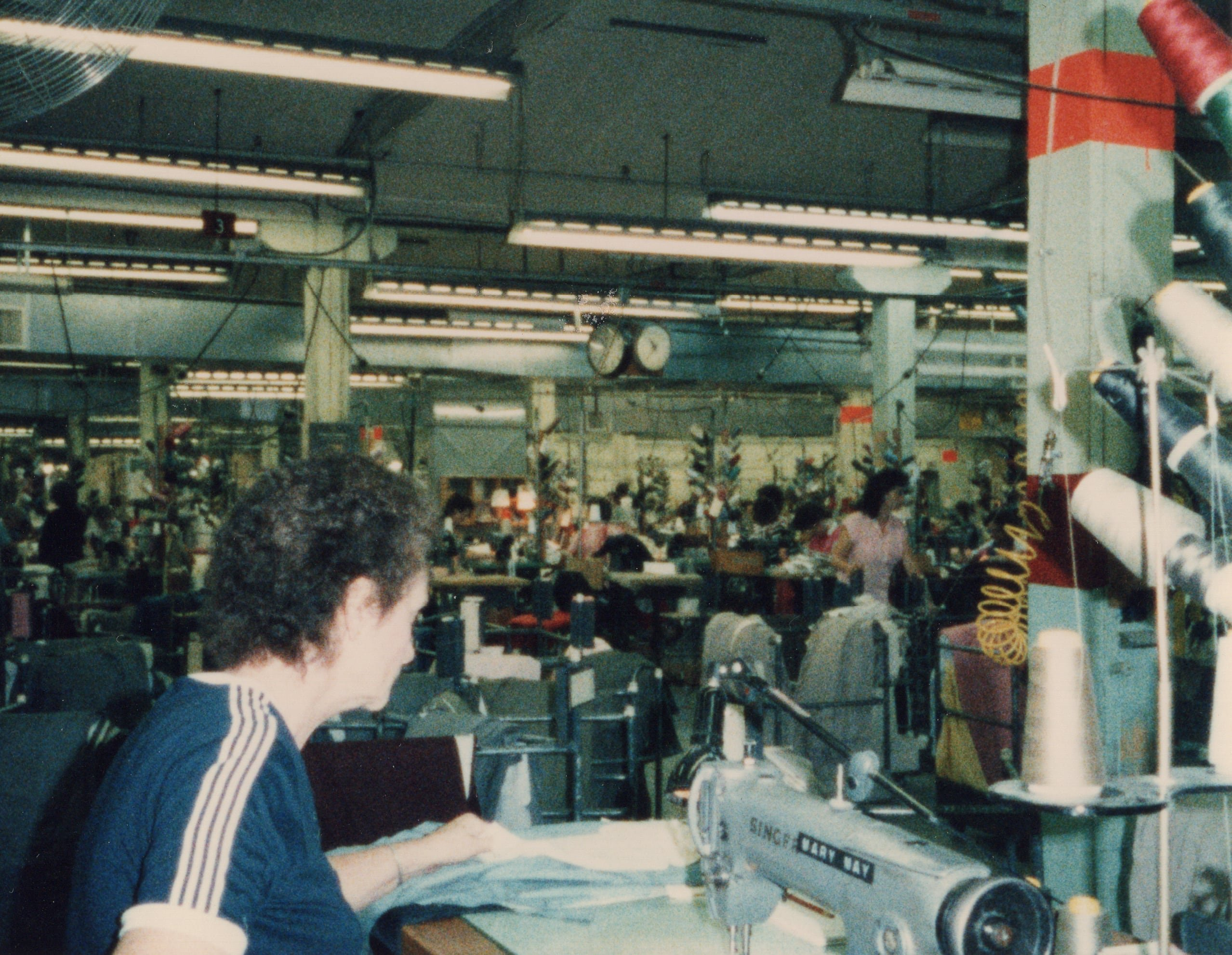 Corbin Ltd. Machine Operator Jeanette Mays sewing back pockets on trousers, Huntington, WV, 1985