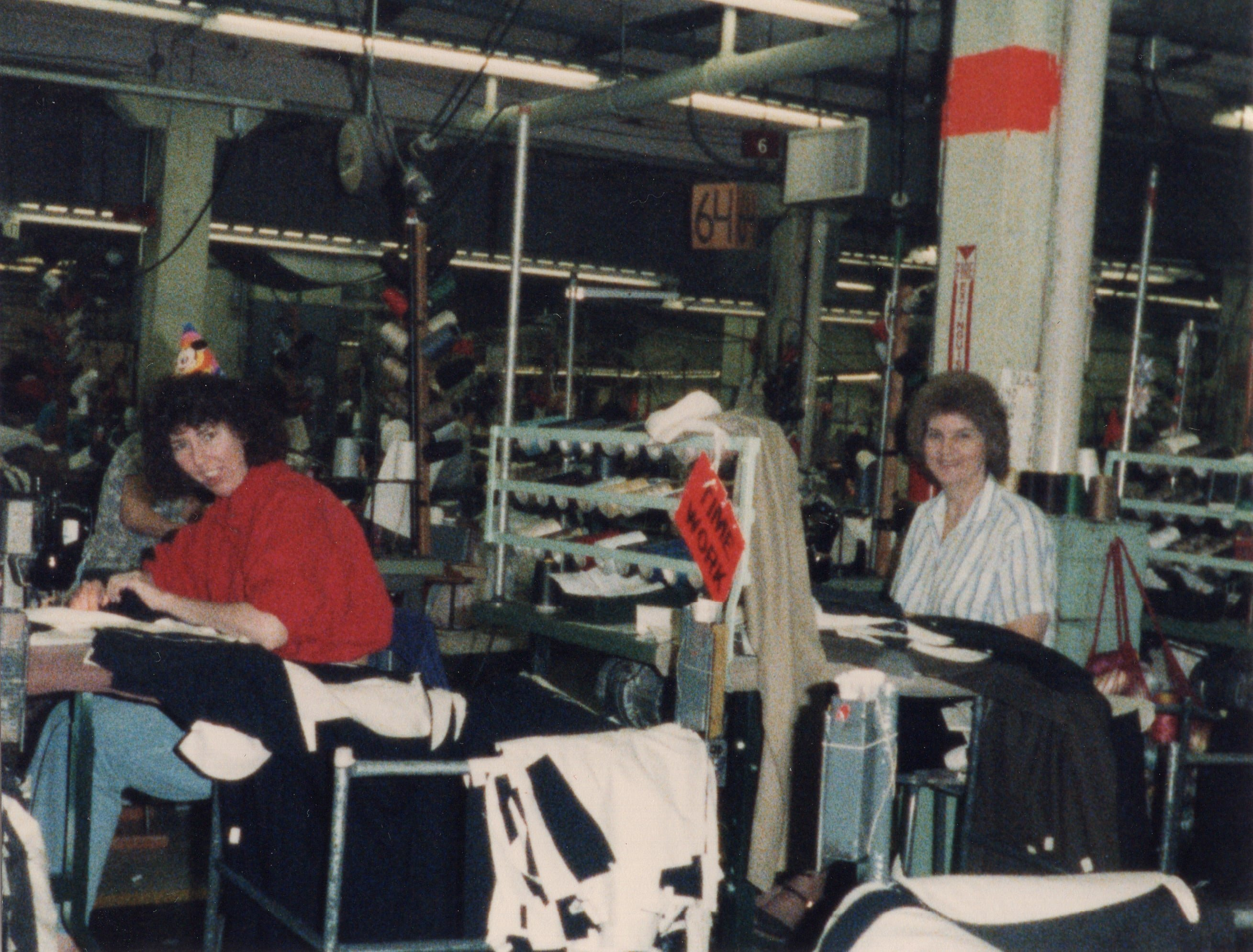 Corbin Ltd. Machine Operators Linda Collins and Becky Chaffin sewing front pockets on trousers, Huntington, WV