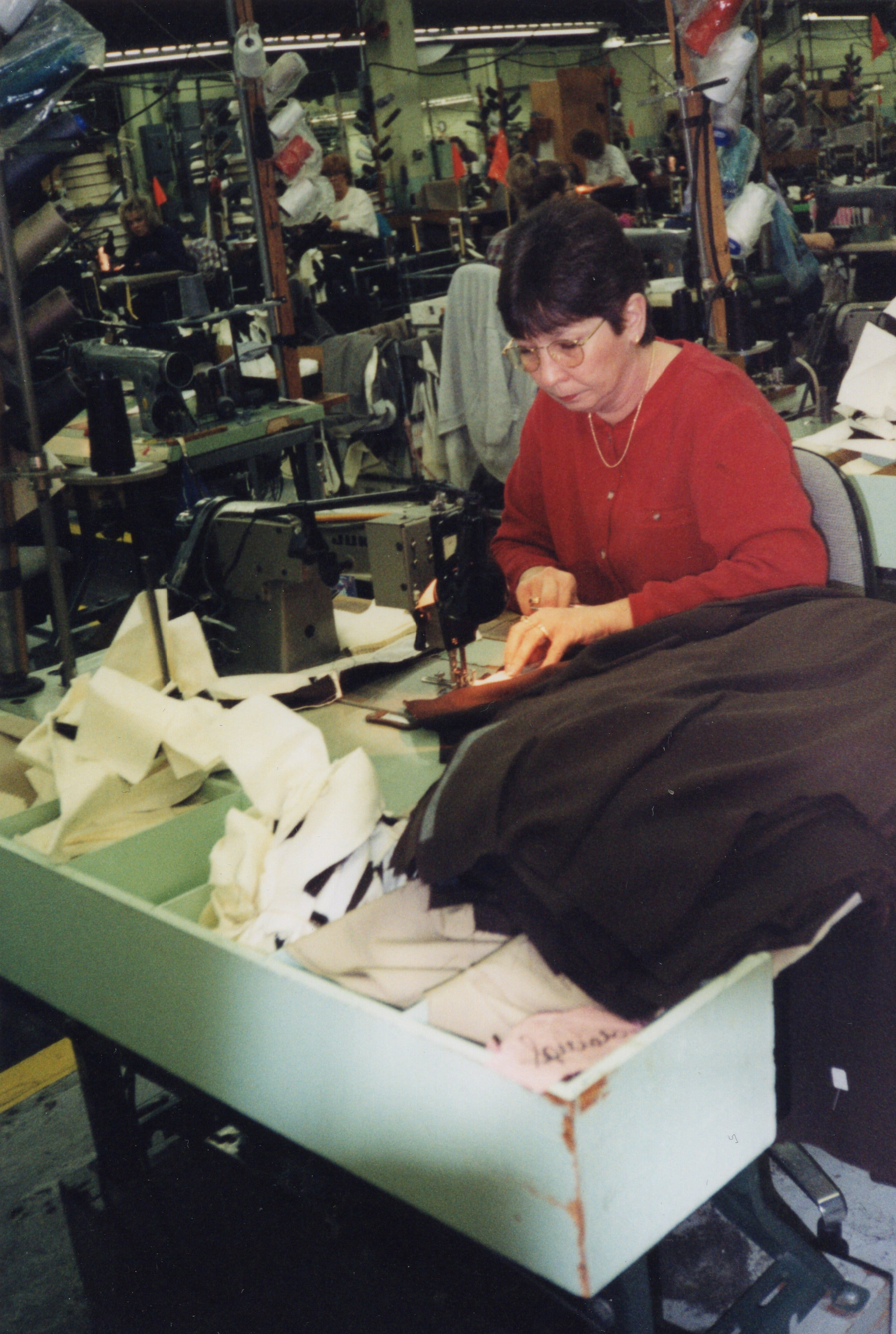 Corbin Ltd. Machine Operator Sheila Graham sewing front pockets on trousers, Huntington, WV