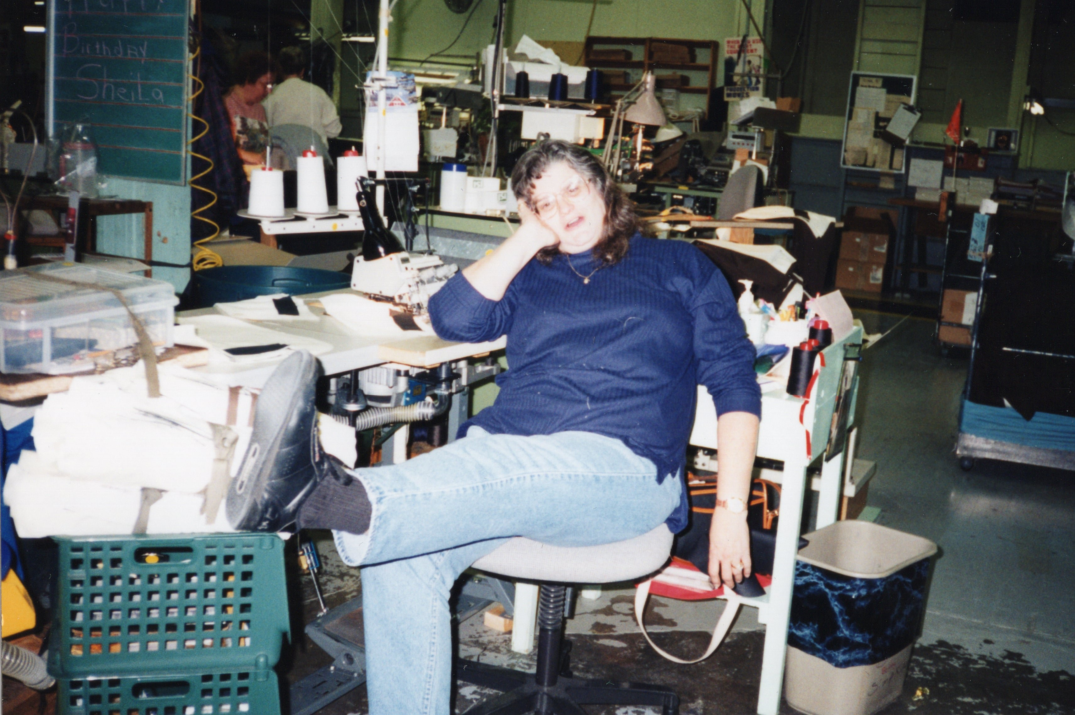 Corbin Ltd. Machine Operator Brenda Seary on break at her machine, Huntington, WV