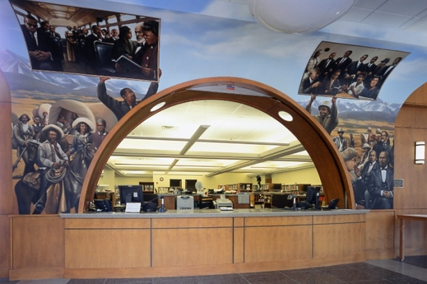 The library's main circulation desk is surrounded by this mural showing African American history and black contributions to the city of Denver.